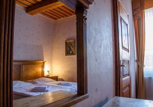 Posteľ alebo postele v izbe v ubytovaní Penzión Cosmopolitan I.
