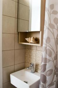A bathroom at INSPIRATION Guestroom with Amazing Roof Garden