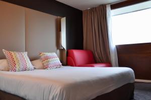 Un ou plusieurs lits dans un hébergement de l'établissement Campanile SETE - Balaruc