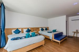 A bed or beds in a room at Paradise Resort Phi Phi-SHA Plus