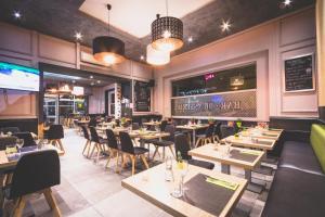 Restaurant ou autre lieu de restauration dans l'établissement Hotel Actuel Chambéry Centre Gare