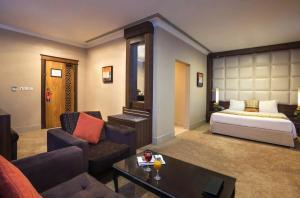 Uma área de estar em Gloria Inn Riyadh