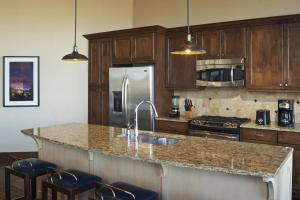 A kitchen or kitchenette at Sunrise Lodge, a Hilton Grand Vacations Club