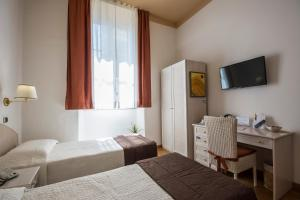 A bed or beds in a room at Piazza Paradiso Accommodation
