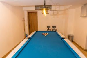 A pool table at Homy Residence