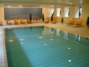 The swimming pool at or near Michel & Friends Hotel Monschau