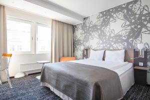 Säng eller sängar i ett rum på Quality Hotel Luleå