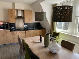 Küche/Küchenzeile in der Unterkunft De Eerste Stuiver