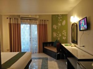 A television and/or entertainment center at Anyavee Ban Ao Nang Resort