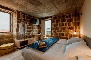 Cama o camas de una habitación en Palacio Condes de Cirac