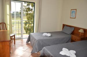 A bed or beds in a room at Casa do Poco
