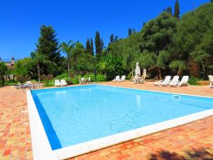 The swimming pool at or near Case Di Latomie