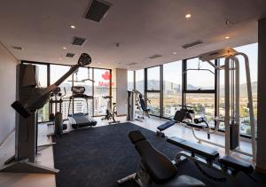 The fitness centre and/or fitness facilities at Maple Hotel & Apartment