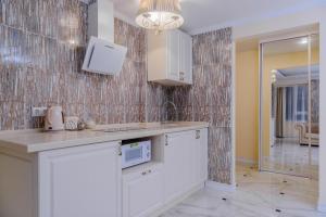 Кухня или мини-кухня в Апарт-отель Кутузов