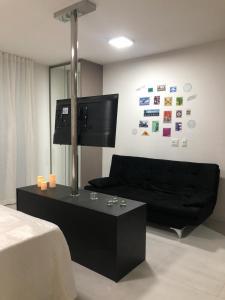 A television and/or entertainment centre at Edificio Time apartamento 1404