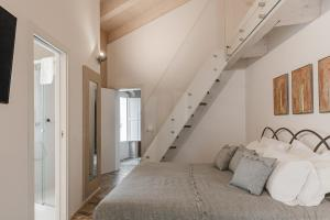Cama o camas de una habitación en Cenobio Hotel