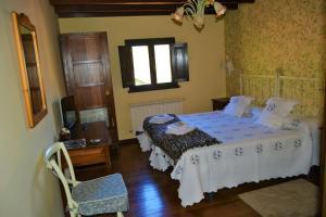 Cama o camas de una habitación en Hotel Rural La Corte