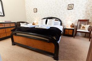 A bed or beds in a room at Coppice House