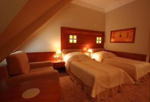 Łóżko lub łóżka w pokoju w obiekcie Hotel Sahara