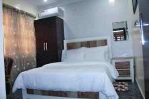 A bed or beds in a room at Mitos Luxury Suites