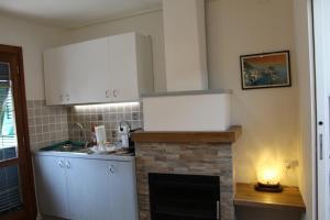 Cuisine ou kitchenette dans l'établissement Rina Rooms