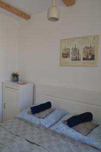 Posteľ alebo postele v izbe v ubytovaní Historical apartments V18