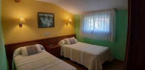 A bed or beds in a room at Pensión Toranda