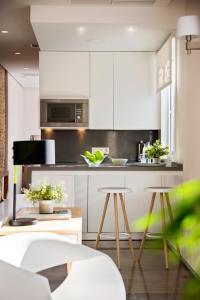 A kitchen or kitchenette at Torre Homenaje Historical Suites