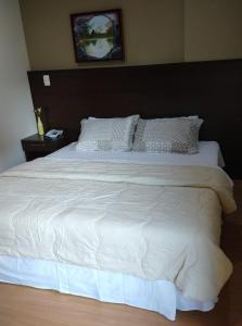 A bed or beds in a room at Apt 109 Mont Blanc Apart Hotel