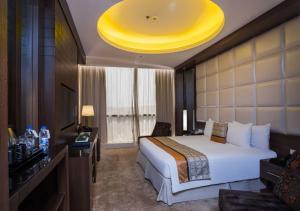Cama ou camas em um quarto em Gloria Inn Riyadh