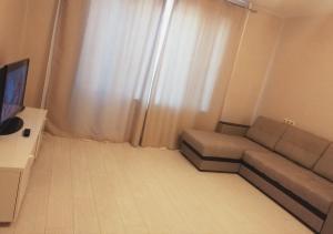 "A seating area at Апартаменты ""Like Home"" на площади Ленина"