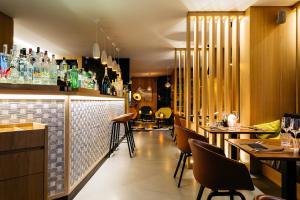 Een restaurant of ander eetgelegenheid bij Boutique Hotel 'Hof ter Duinen'