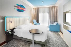 Cama ou camas em um quarto em Park Inn by Radisson Makkah Al Naseem