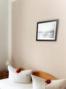 Ein Bett oder Betten in einem Zimmer der Unterkunft FerienResidenz MüritzPark