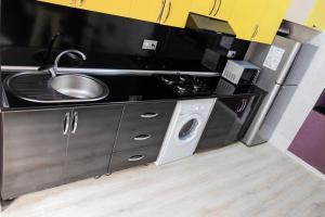 A cozinha ou cozinha compacta de Travel Inn Hostel