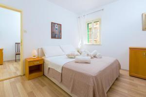 A bed or beds in a room at Gaius Aurelius Valerius in Split Centre
