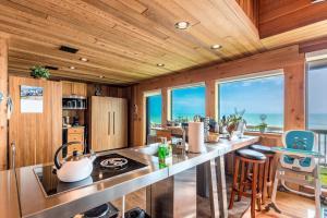 A kitchen or kitchenette at Restoration Sands