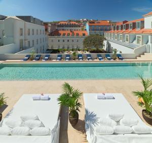 The swimming pool at or near The One Palácio da Anunciada