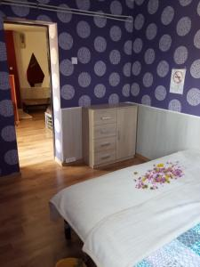 A bed or beds in a room at Málnás Motel