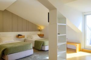 A bed or beds in a room at Hotel Laranjeira