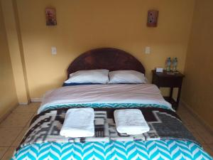 A bed or beds in a room at B&B Sun Gate
