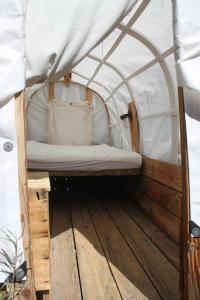 A bed or beds in a room at Virginia Creek Settlement