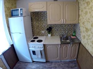 Кухня или мини-кухня в Apartment Like Your Home