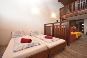 Postel nebo postele na pokoji v ubytování Areál Přístav