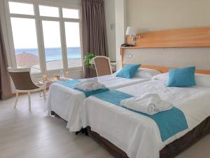 A bed or beds in a room at Hotel & Talasoterapia Zelai