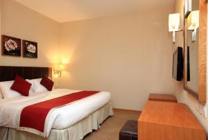 سرير أو أسرّة في غرفة في جولدن توليب - الجبيل