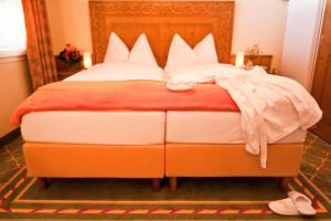 Кровать или кровати в номере Sporthotel Wildstrubel
