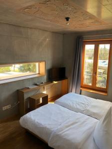 Ein Bett oder Betten in einem Zimmer der Unterkunft Haus 12 Zimmer