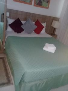 A bed or beds in a room at Apart Hotel Setor Hoteleiro Norte