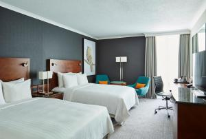 A bed or beds in a room at London Heathrow Marriott Hotel